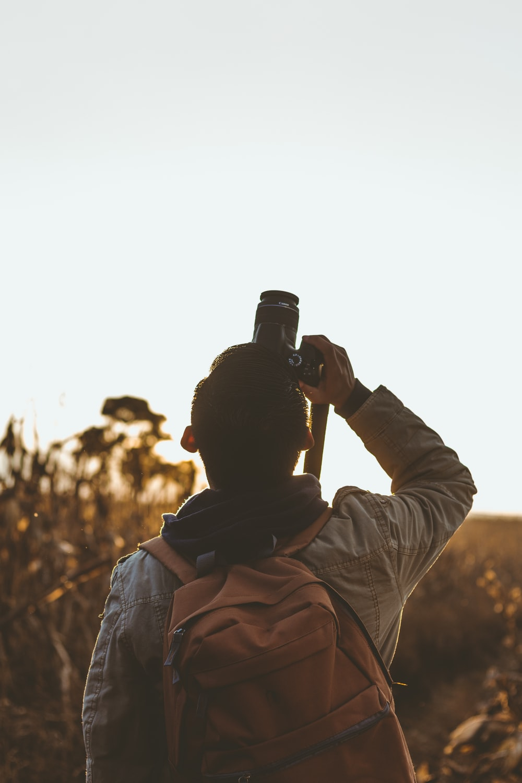 man taking picture using DSLR camera