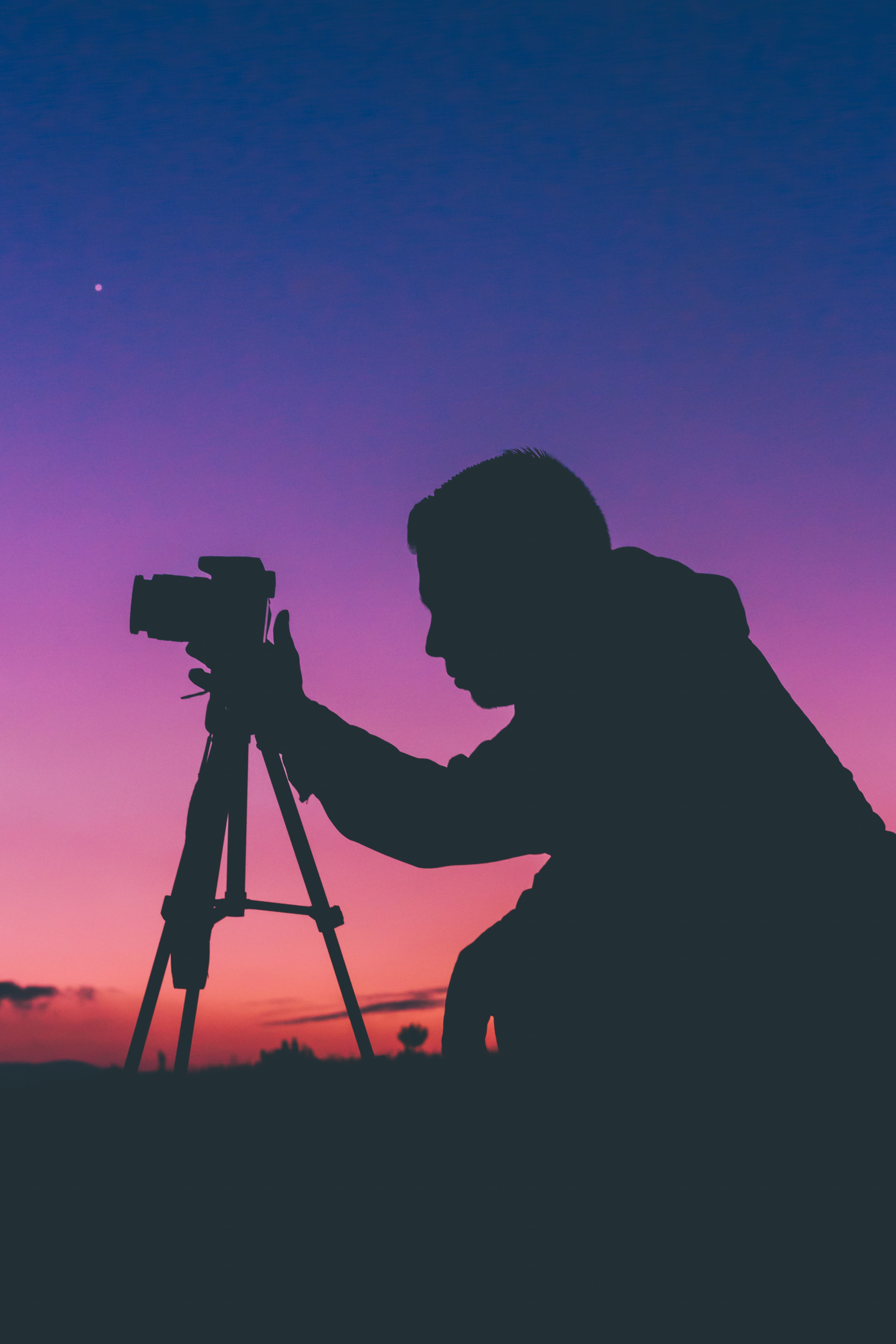 silhouette photography of man talking photo