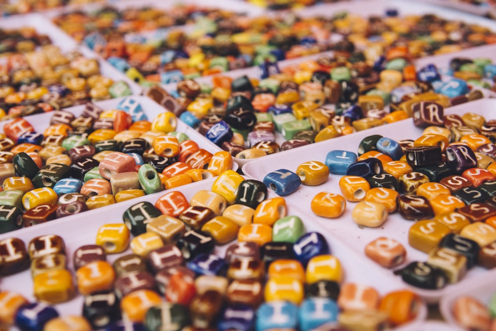 assorted-color bead lot on white tray