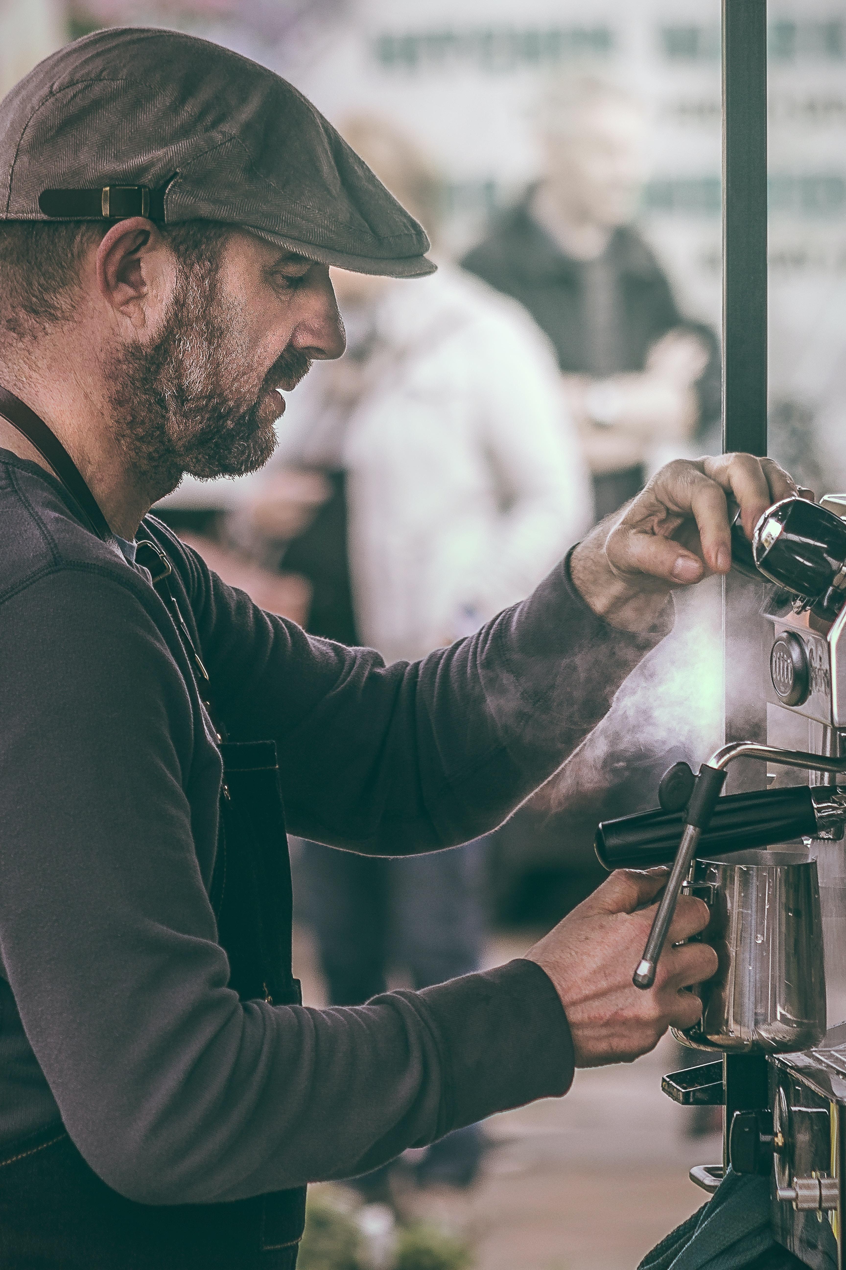 man operating espresso machine