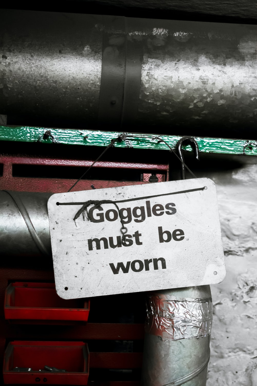 goggle must be worn sign hanging on nail