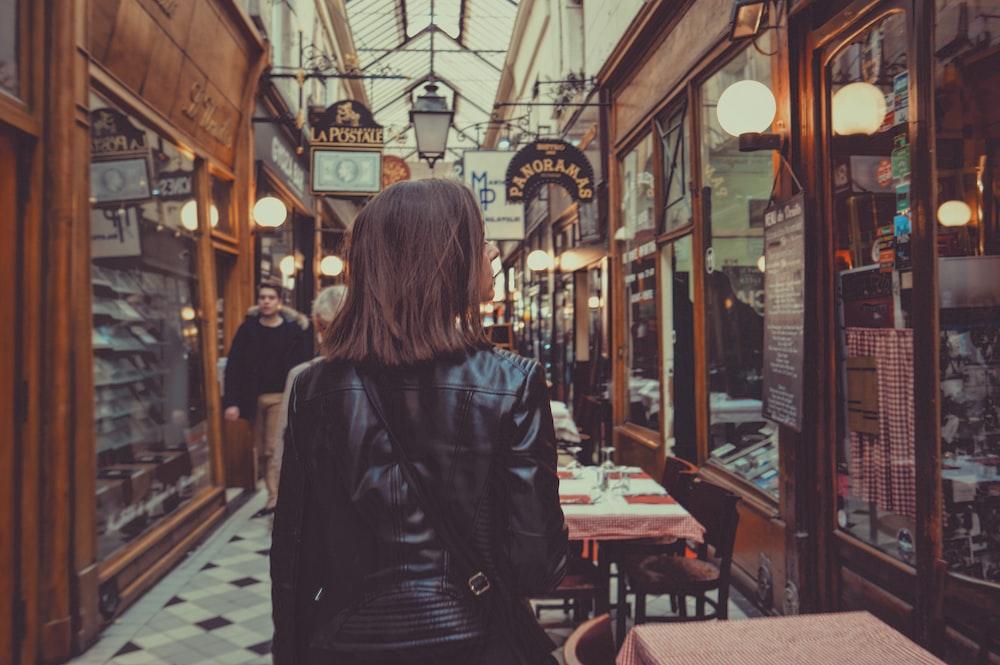 woman walking in hallway