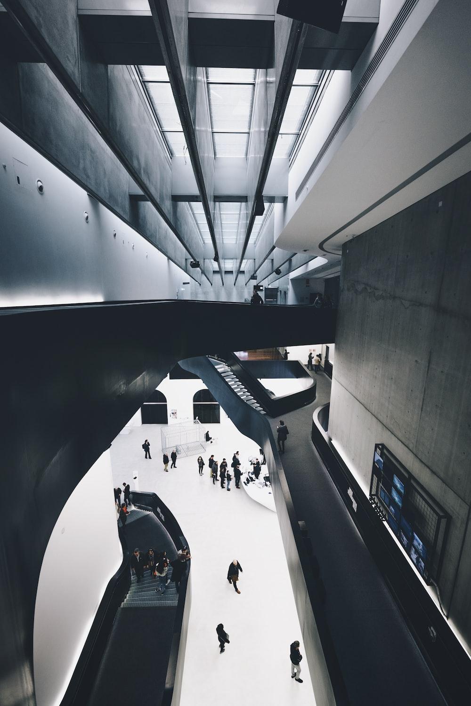 people in suit walking inside a building