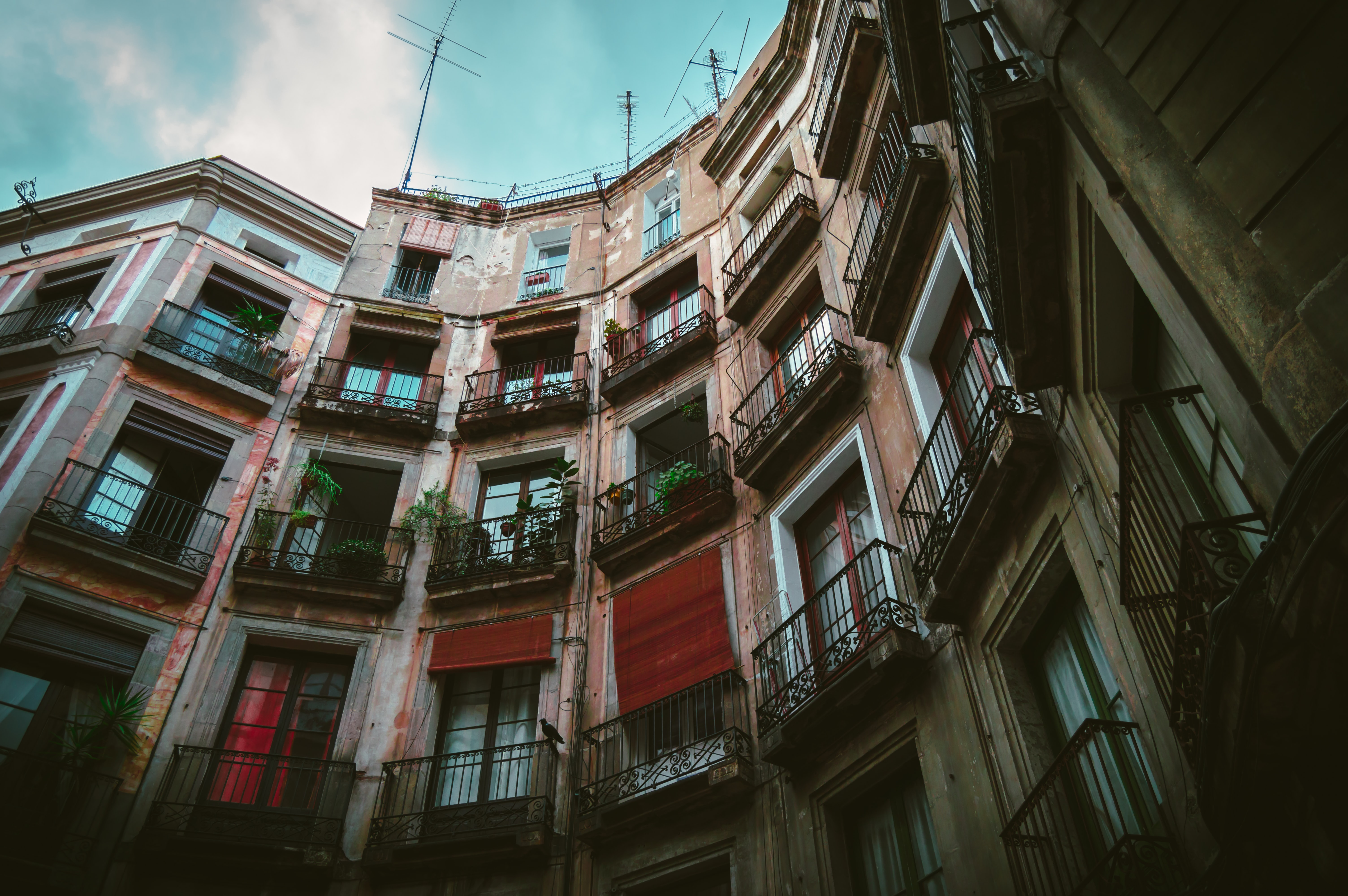multicolored apartment building in low angle photography