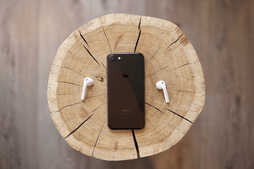 space gray iPhone 8 and Apple AirPods