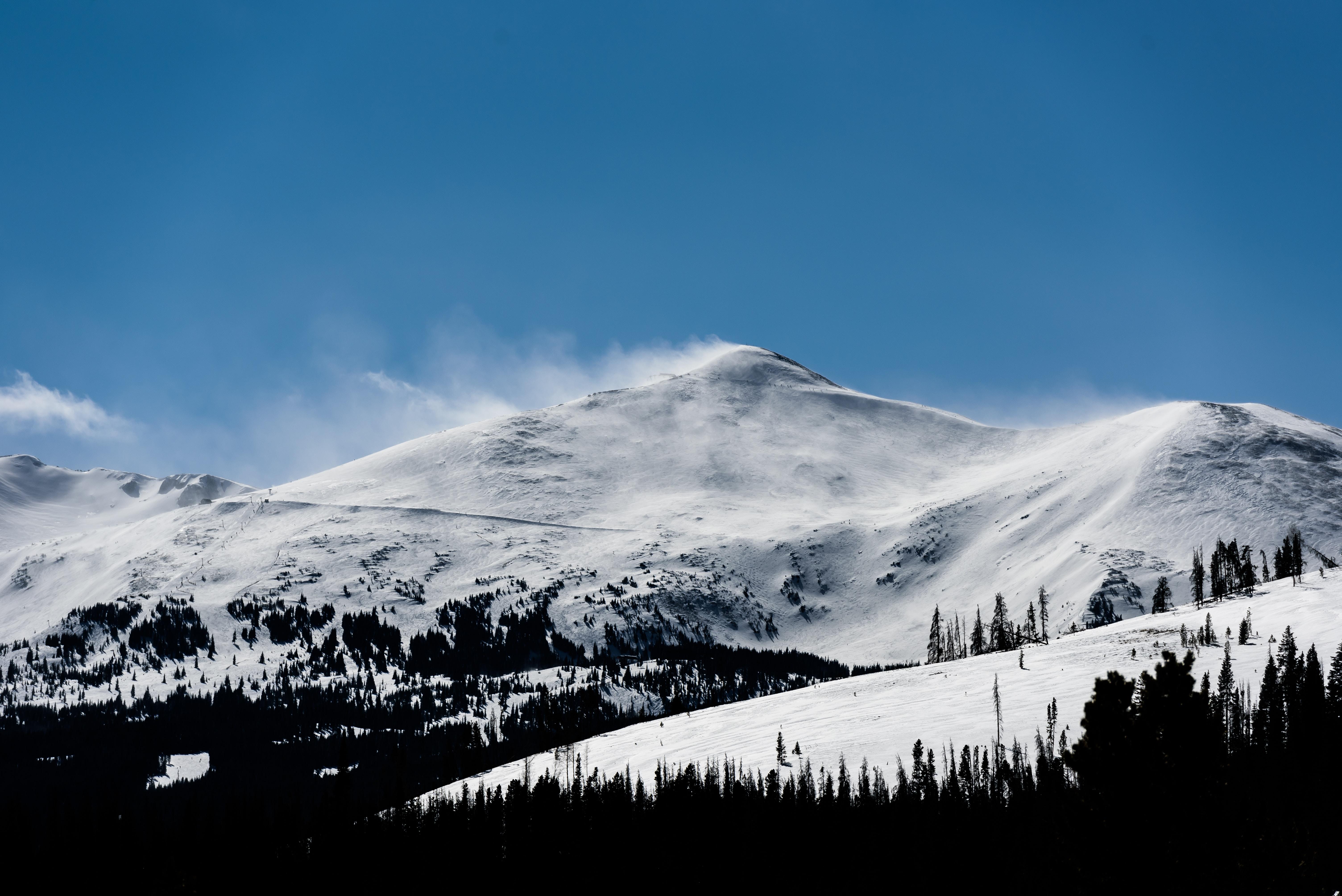 Wind blowing snow off a mountain ridge