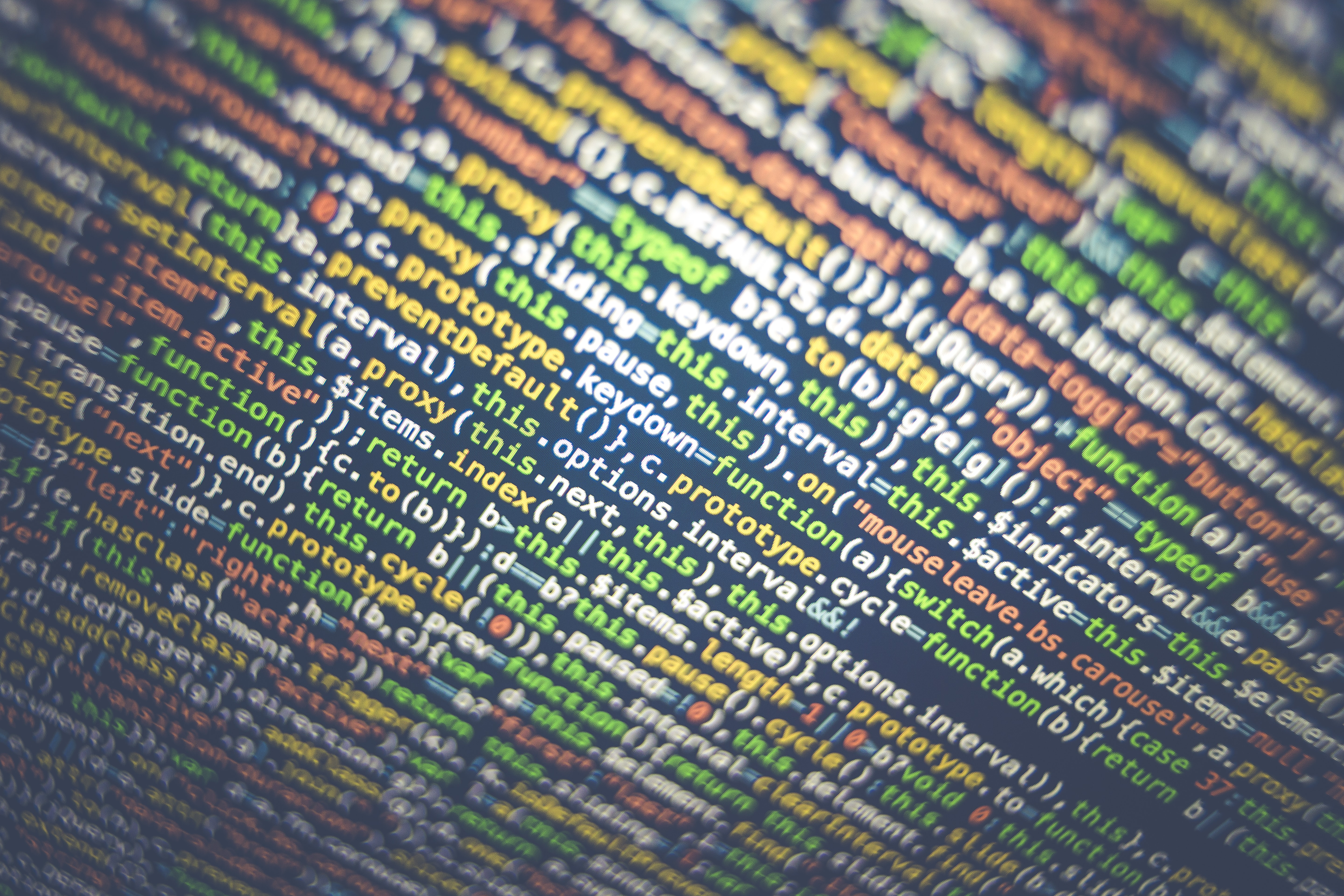 Close-up of colorful lines of code on a computer screen