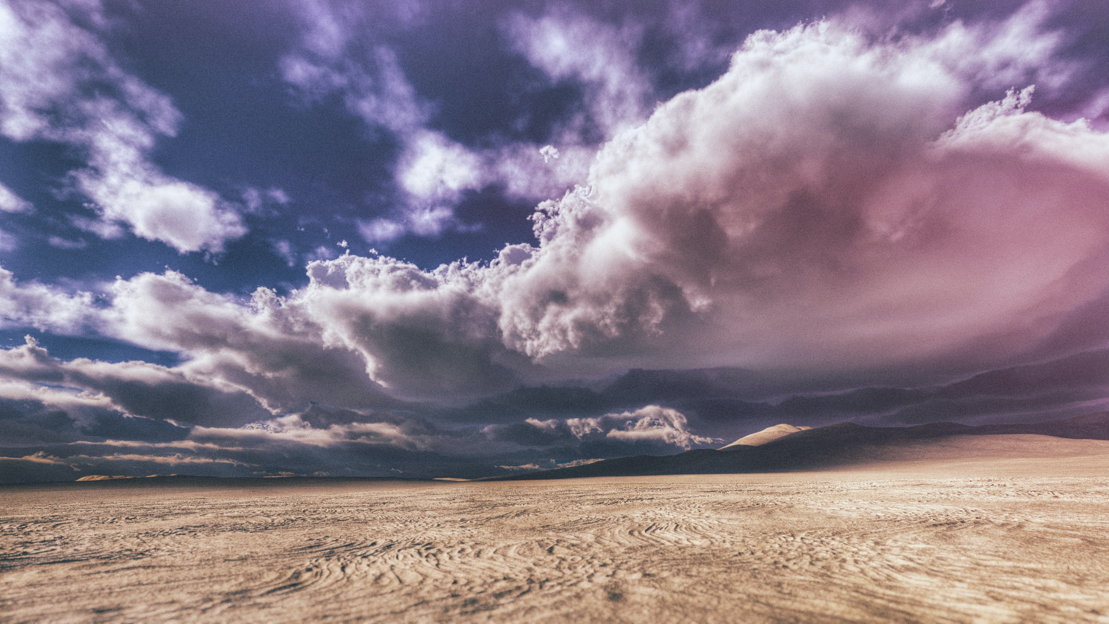 empty desert under gray couldy sky