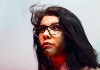 woman wearing eyeglasses looking up