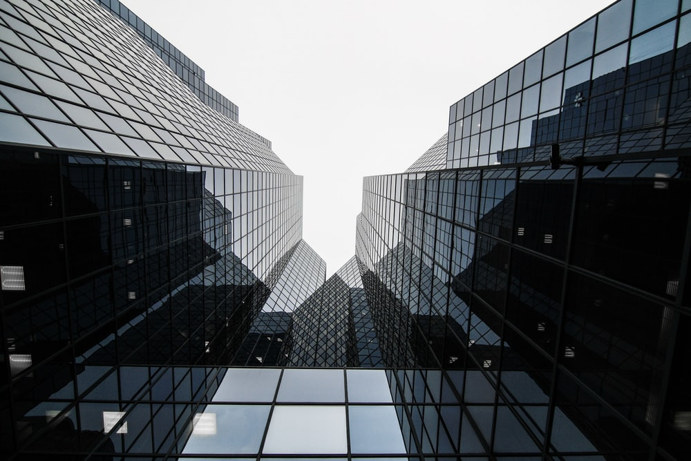 worm's-eye view of glass building
