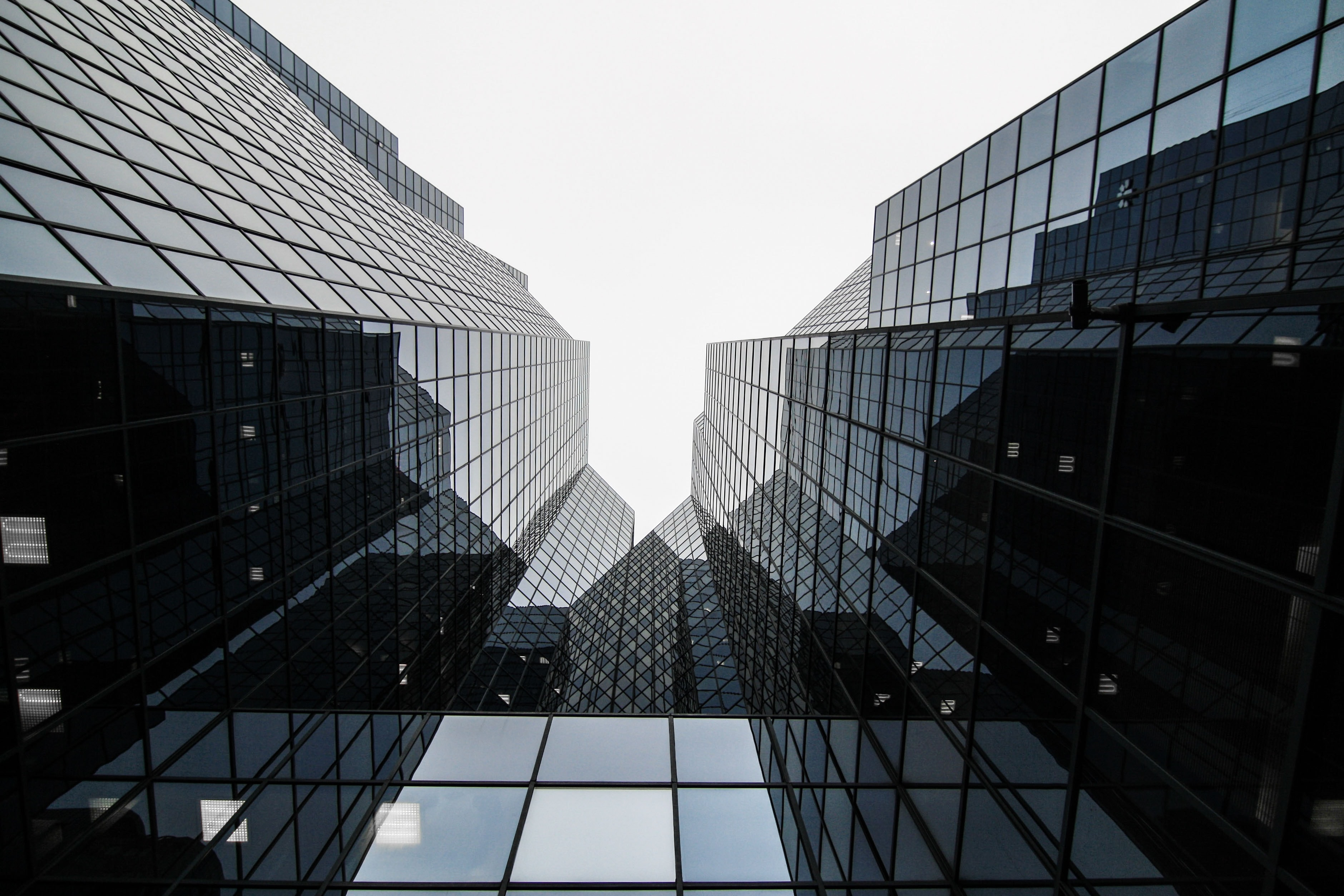A low-angle shot of the reflective glass facade of a skyscraper in Montreal