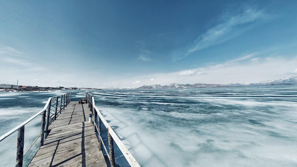 concrete bridge with railings under clear sky