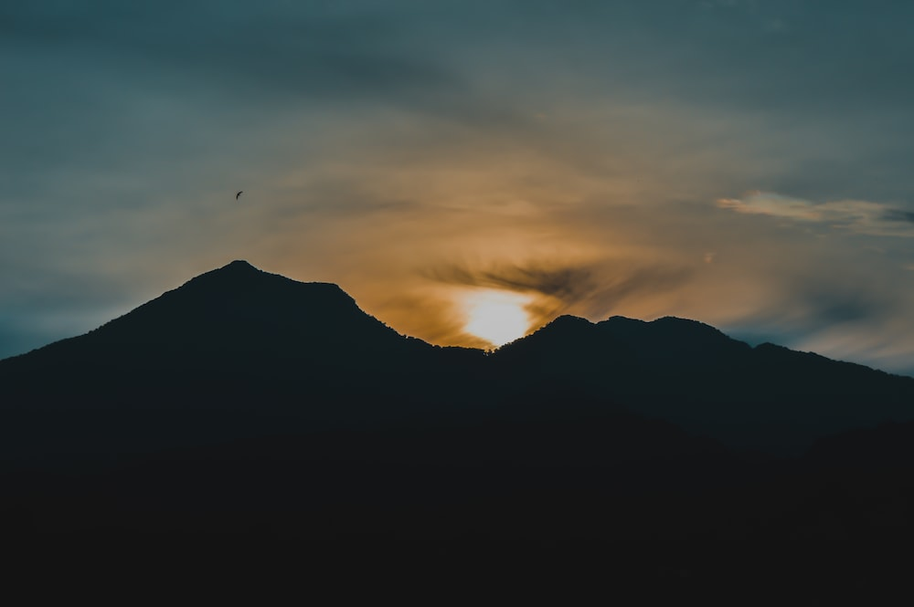 silhouette of mountain during sunrise