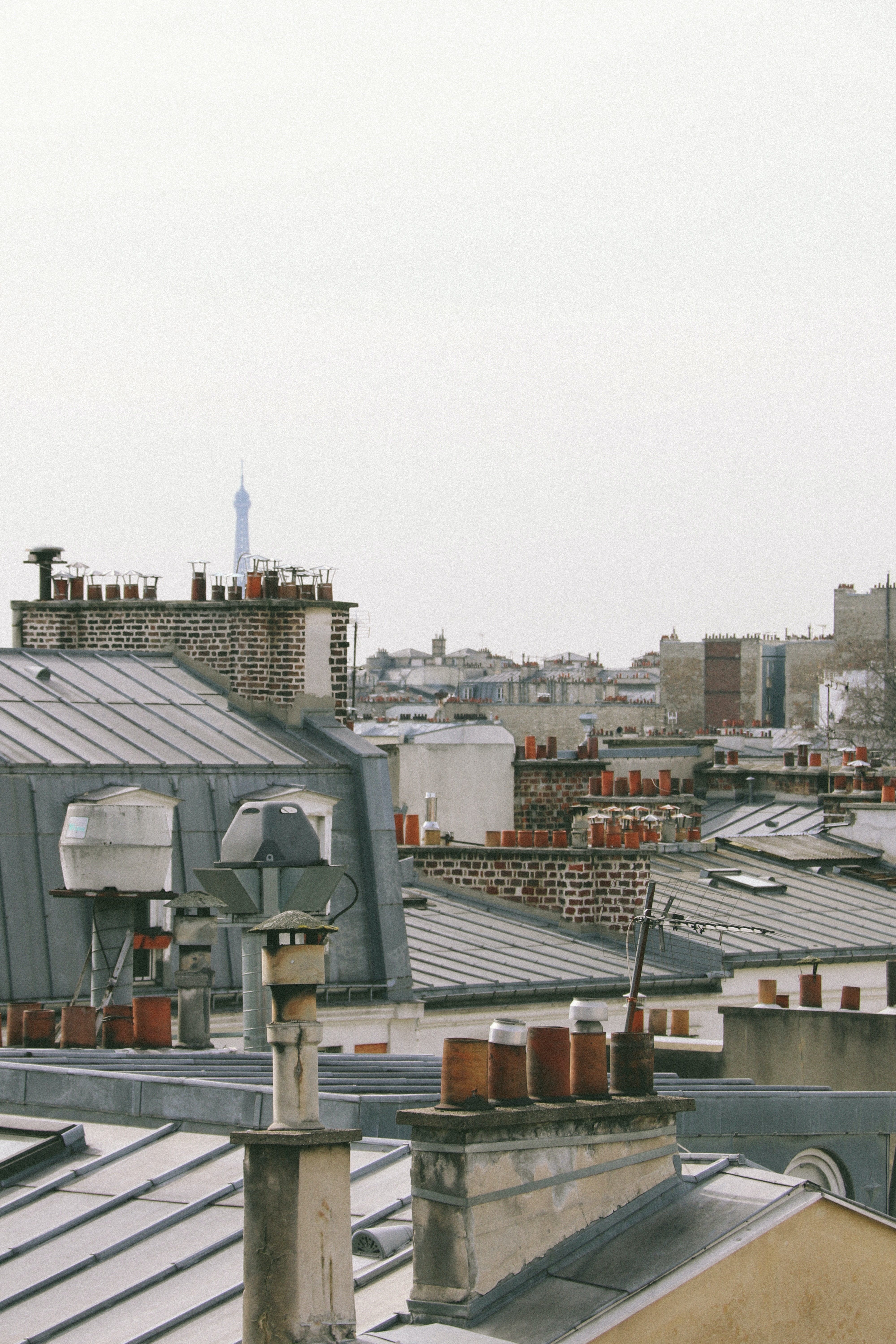 View of rooftops in Paris with brown chimneys