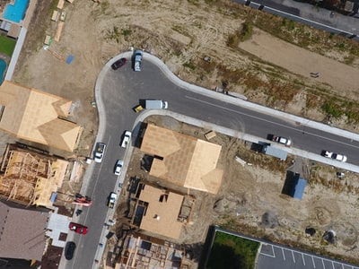 aerial view of vehicles on asphalt road drone view teams background