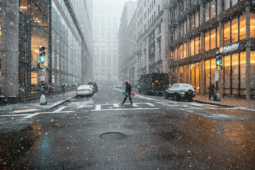 People Walking Through the City in Winter