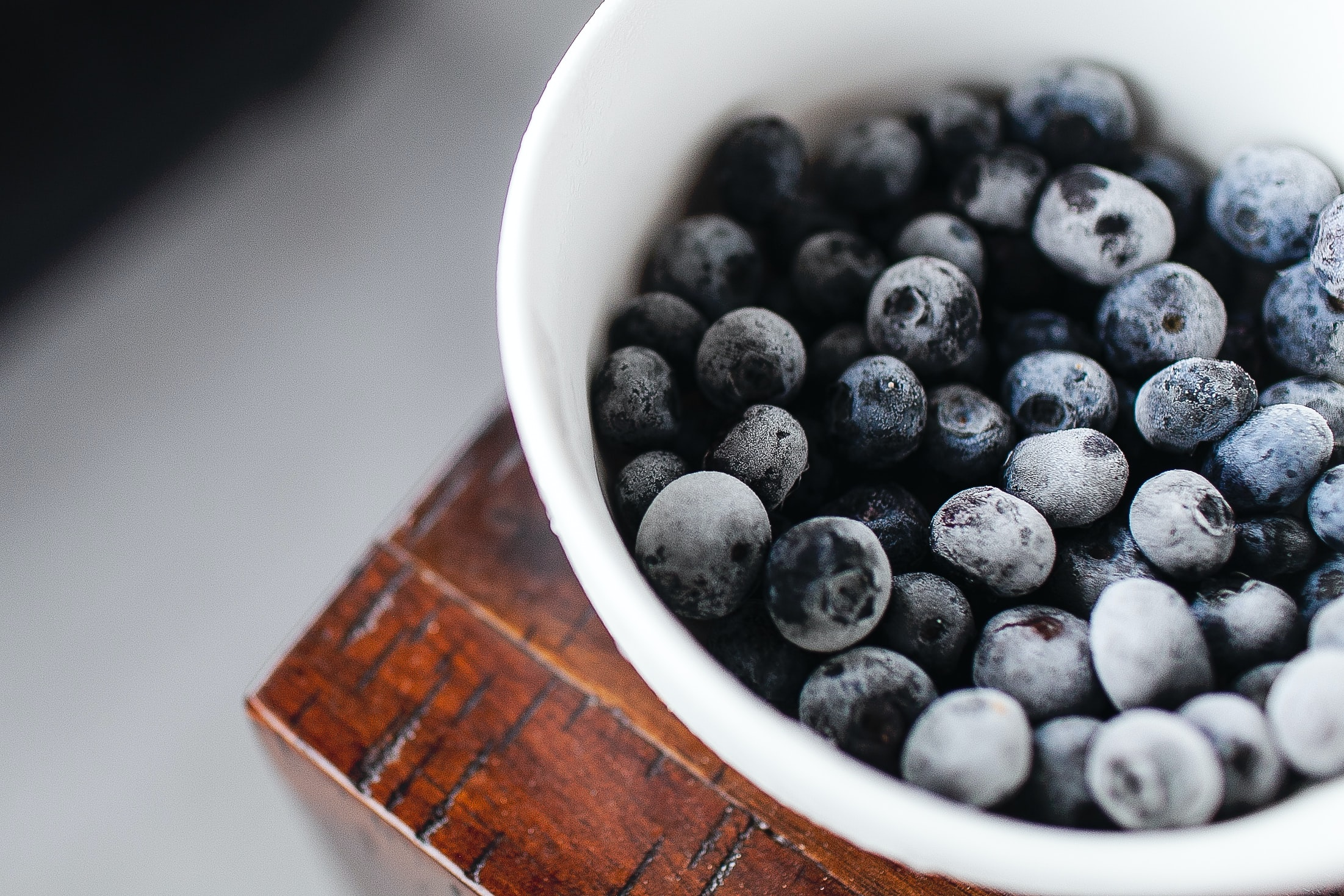Close-up of frozen blueberries in a white bowl