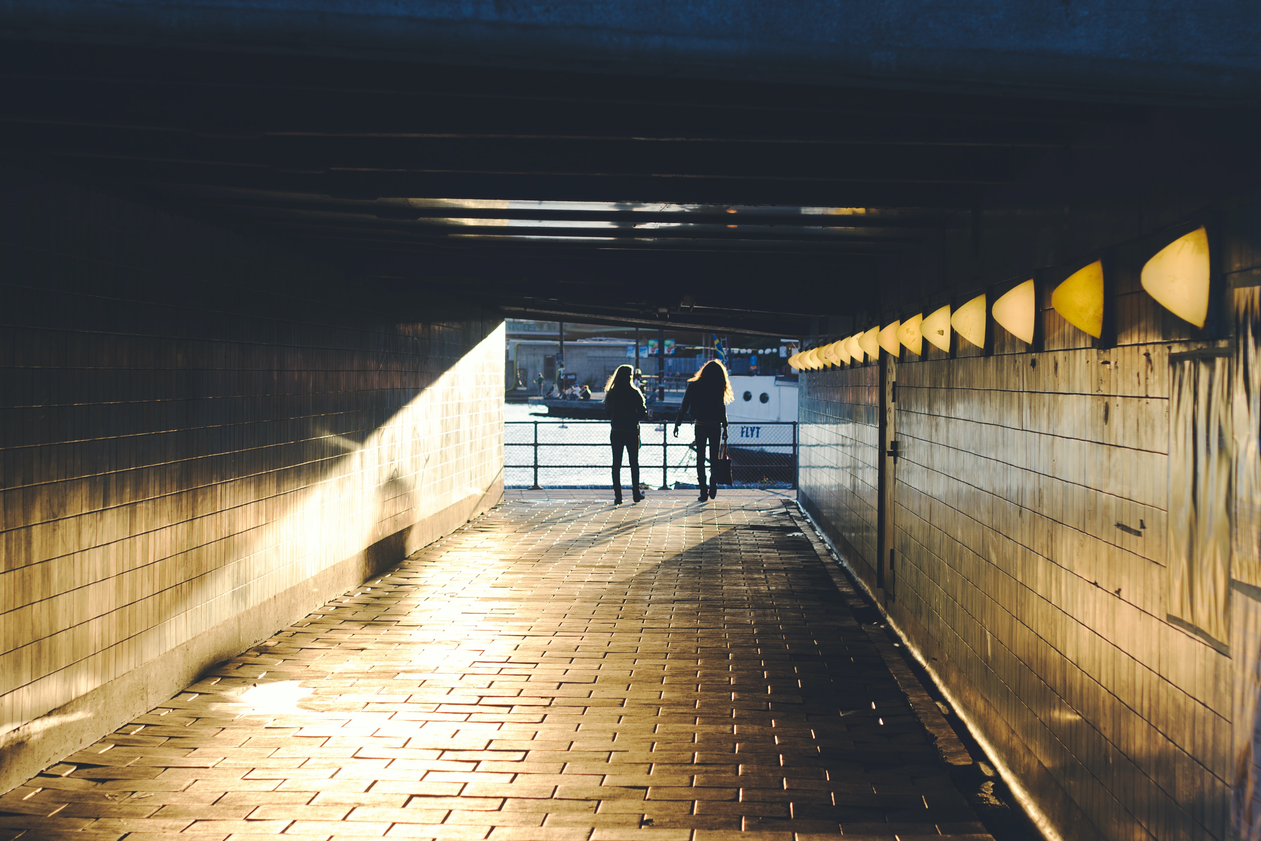 two person walking on hallway