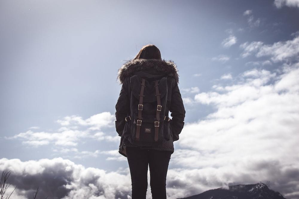 woman looking at clouds under blue sky during daytime