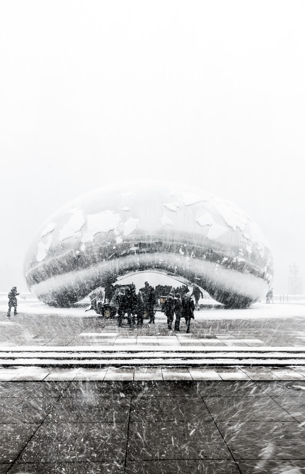 person under cloud gate at Chicago