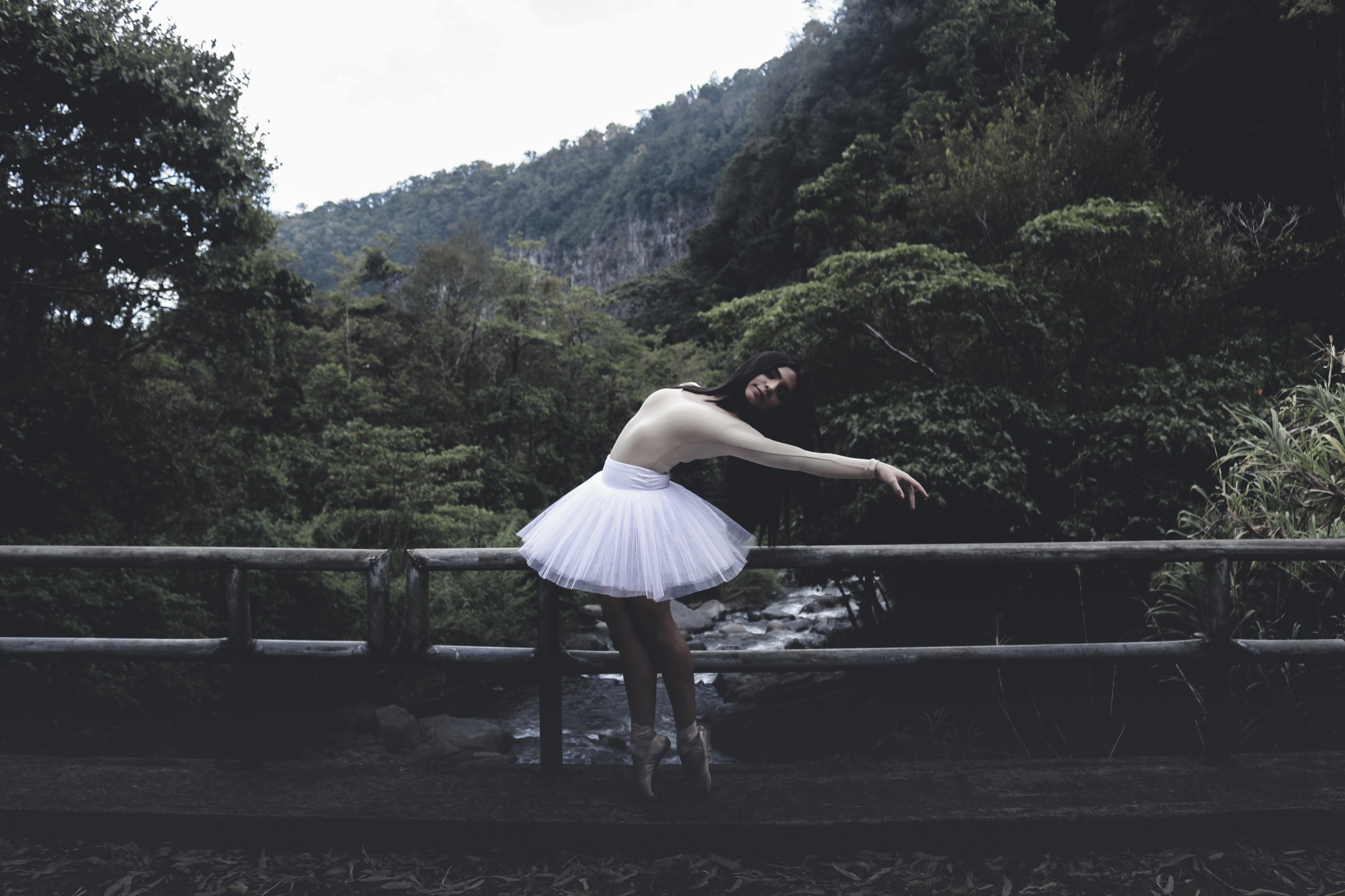woman in tutu dress on bridge
