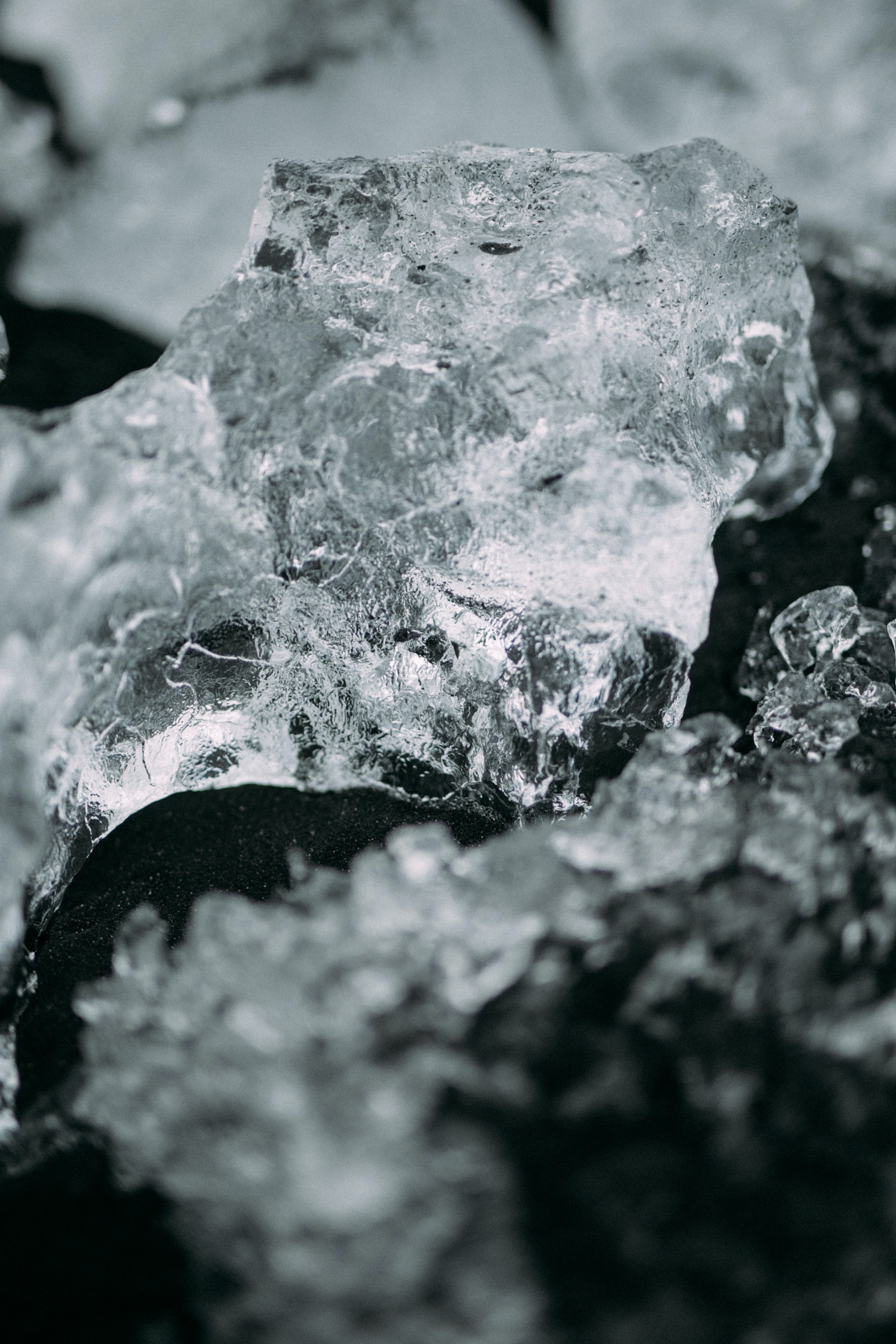 Ice forms into crystal and contrasts with dark soil