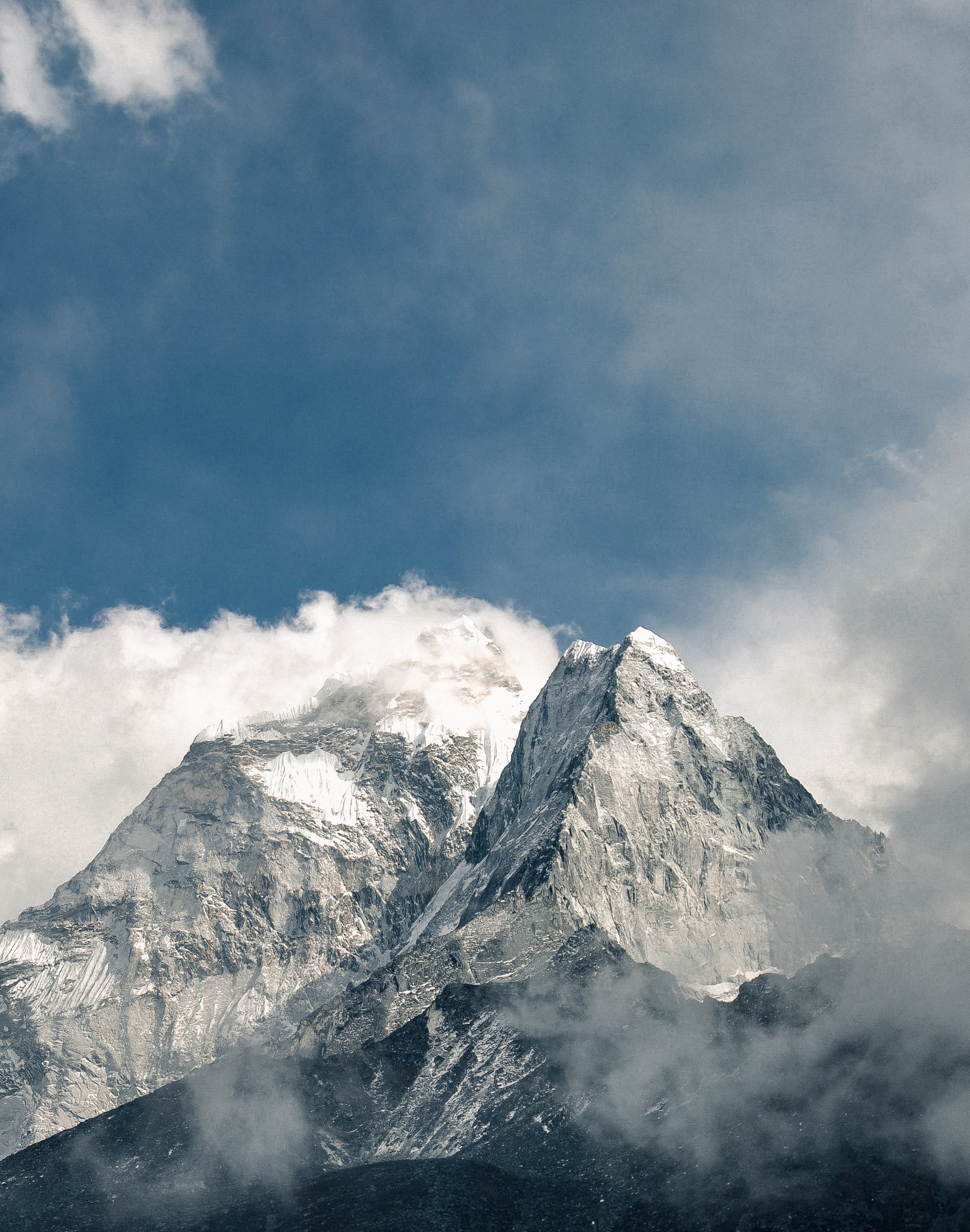 snowy mountain covered by clouds