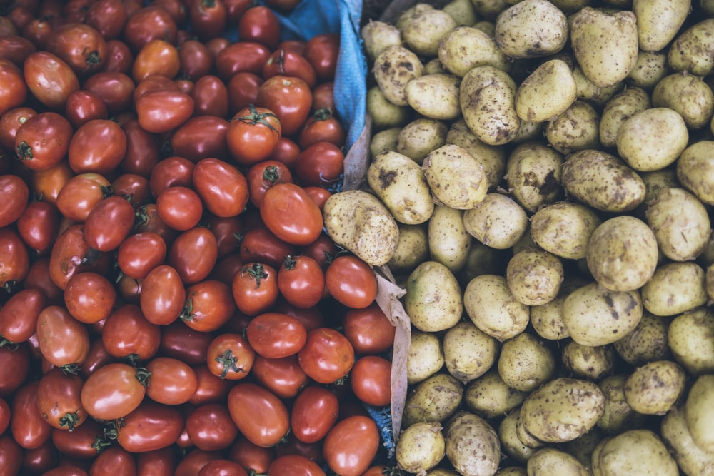 photography of orange tomatoes and brown potatoes
