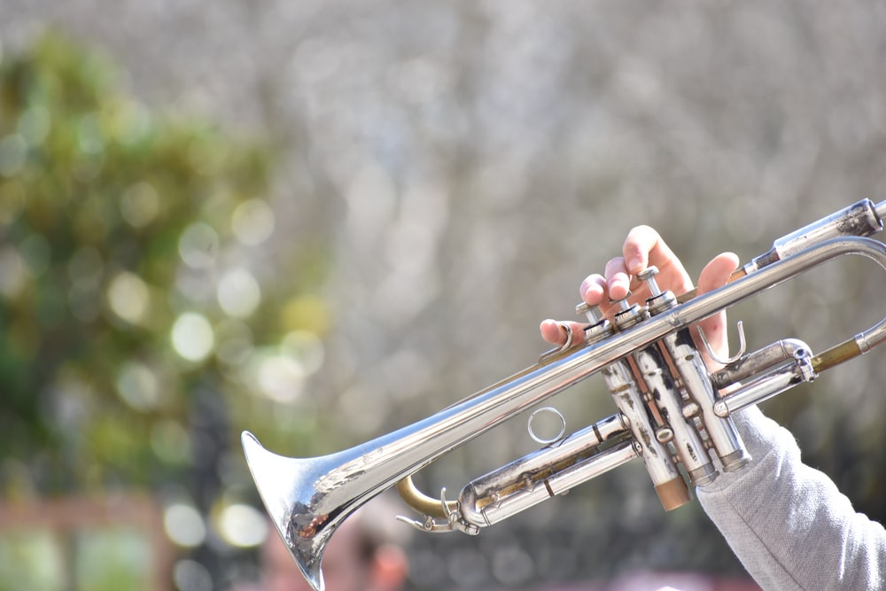 person playing trumpet outdoor