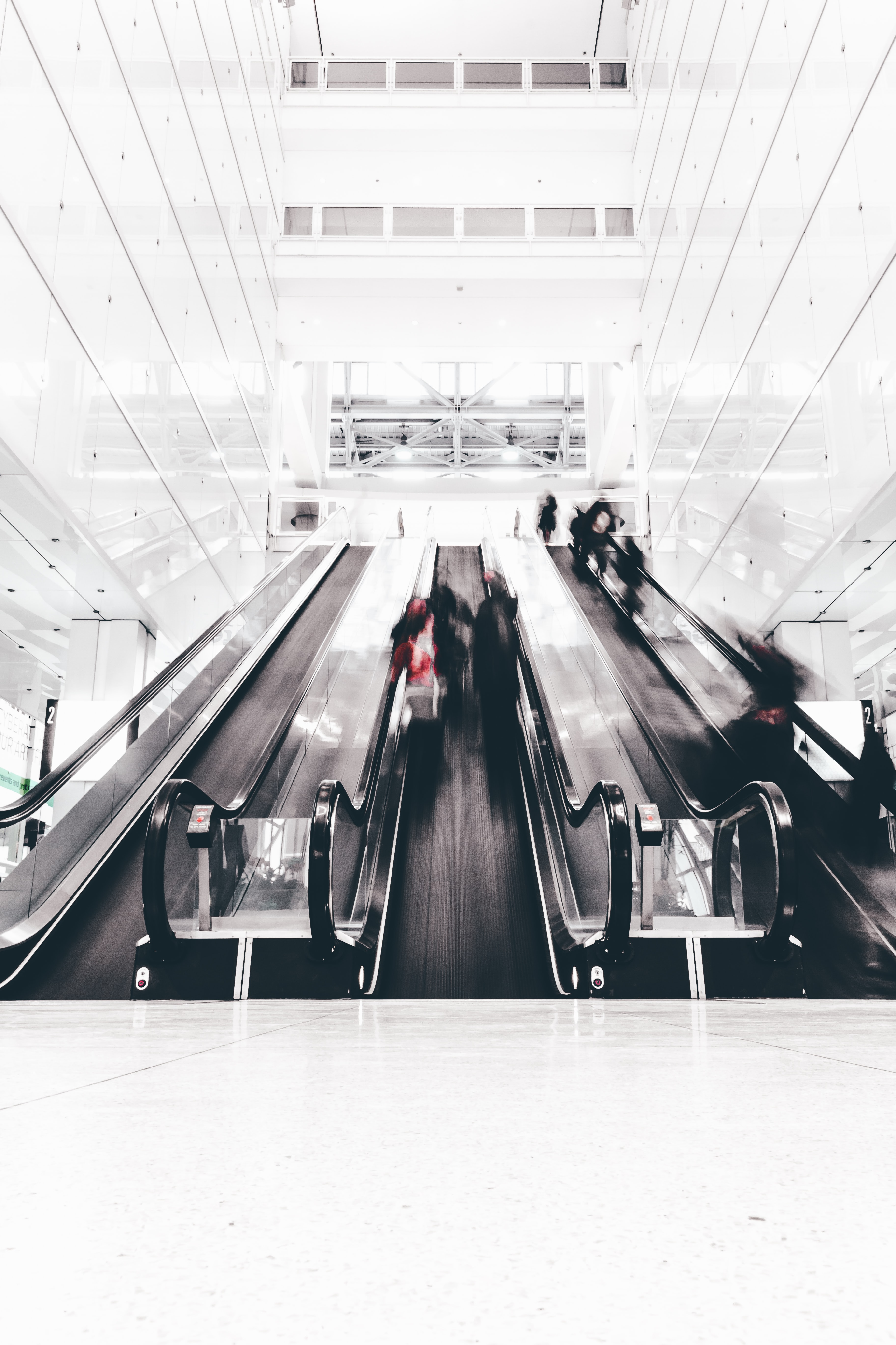 A time exposure shot capturing people using an escalator in a Chicago building