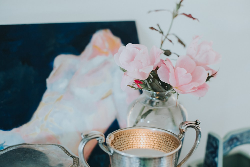 pink flowers on clear glass vase