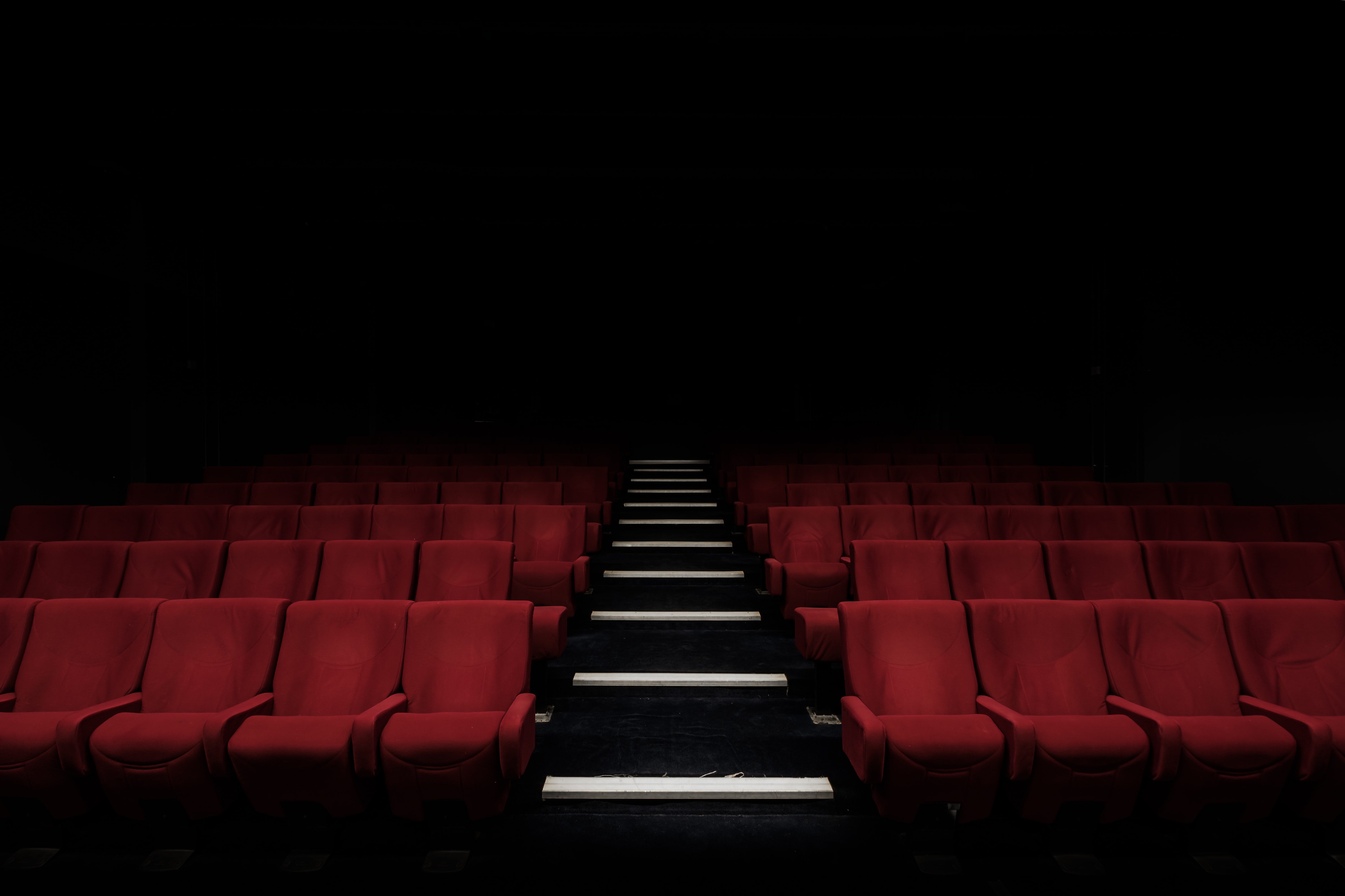 Red theater seats that you would find when watching Christian films