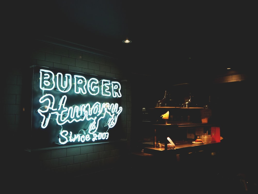 Burger Hungry neon signage mounted on white painted wall