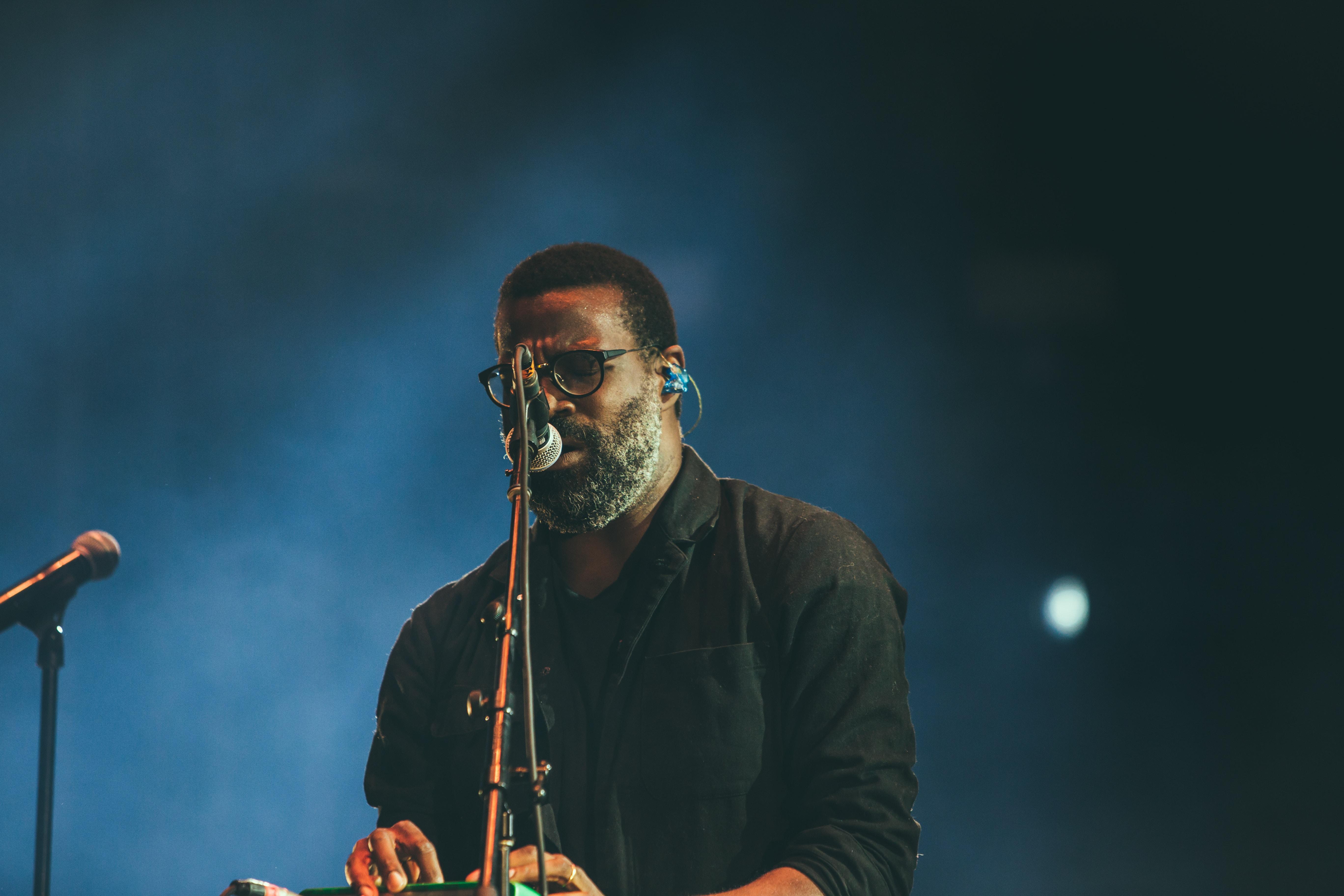man standing facing microphone
