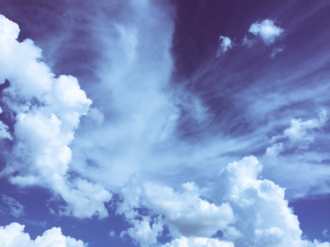 My family and I were at Universal Studios Florida on vacation in July 2016. I happened to look up in the sky and I said to my husband that it looked like an angel was in the clouds.  I quickly grabbed my iPhone and took several photos, including this one.  Later, in March 2017 when I decided to upload the photo to unsplash, I looked closer at the profile and it looks like it could be Jesus praying.  Praise His name!