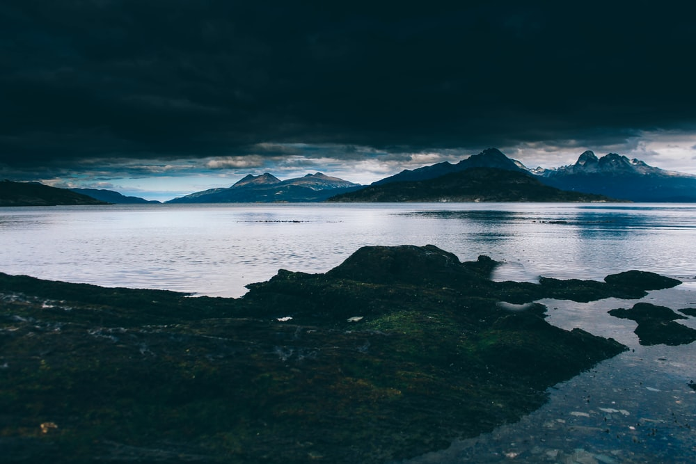 landscape photography of mountain and body of water