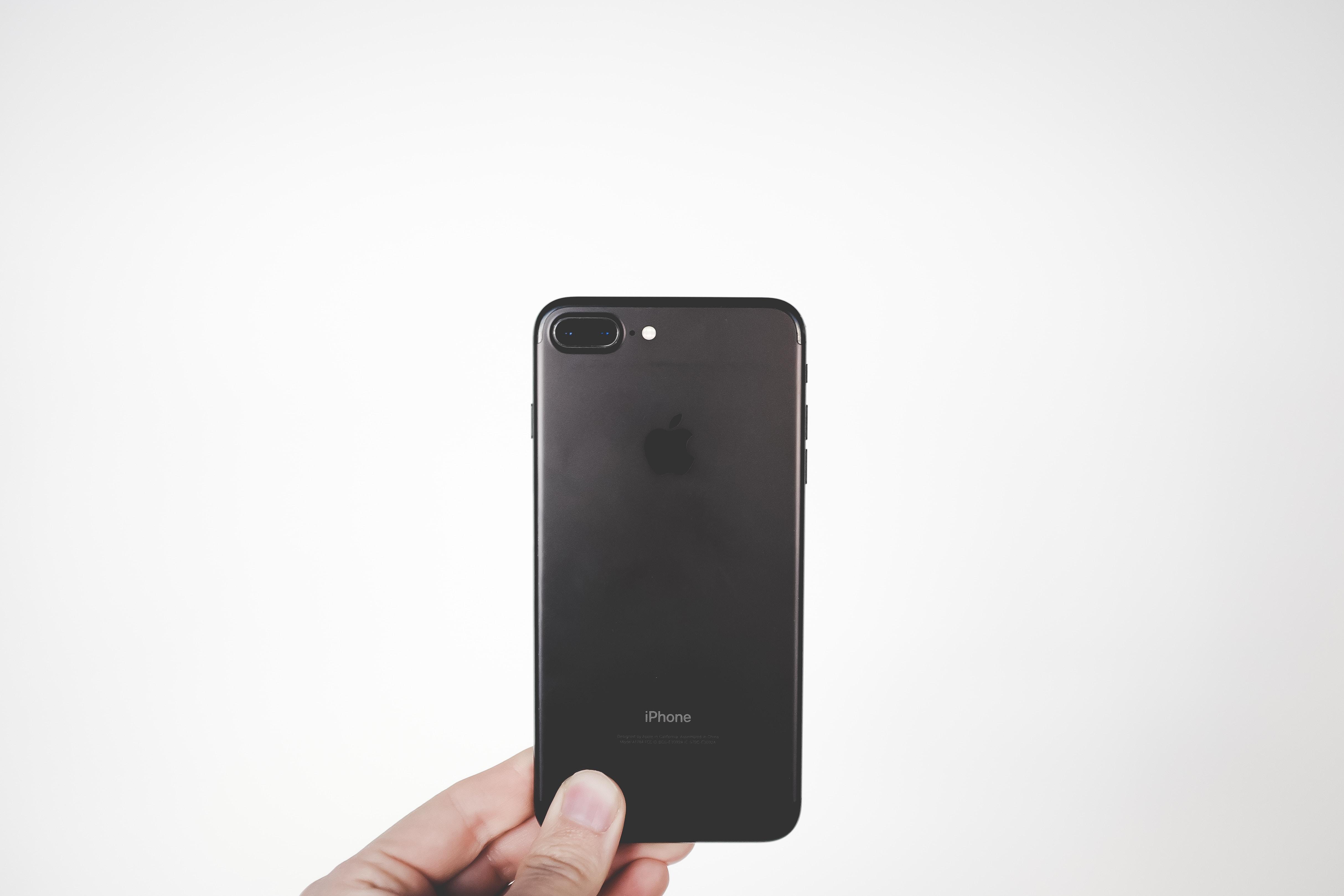 person holding black iPhone 7 Plus