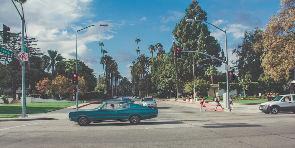 teal car on gray concrete road