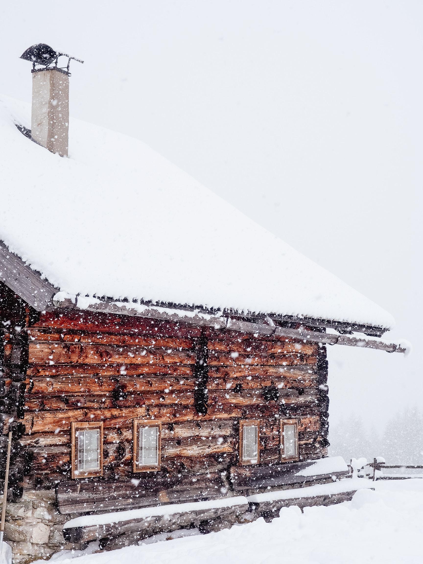 A side view of a snow covered ski lodge, Südwiener Hütte, in Austria
