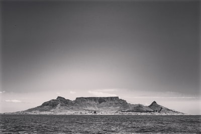 grayscale photo of snow covered mountain cape town teams background