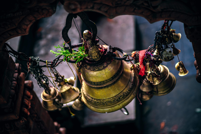 shallow focus photography of brass bell