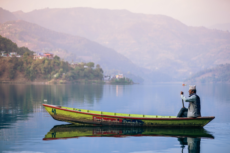 man riding yellow boat