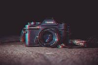 shallow focus photography of black Konica DSLR camera