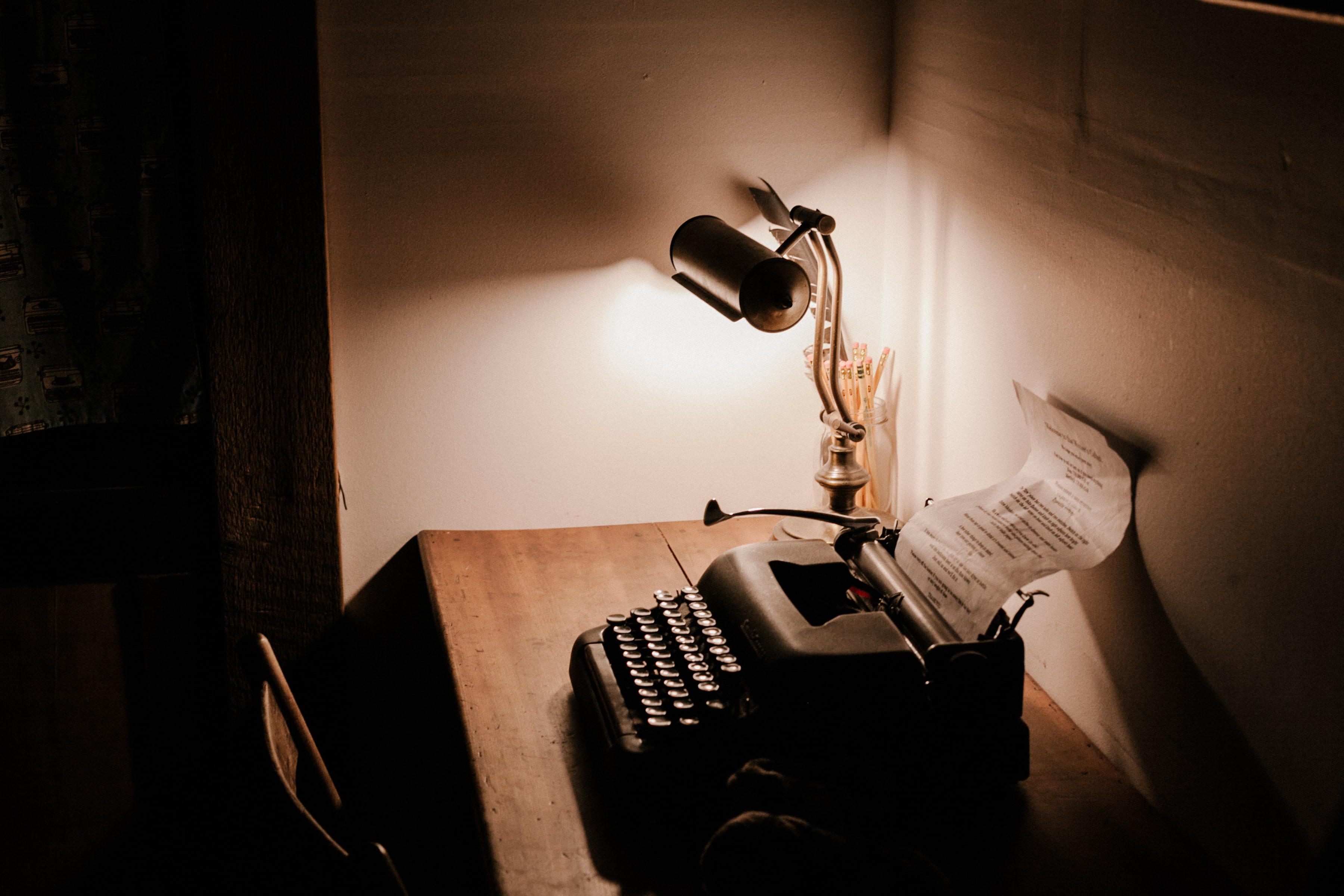 A typewriter and a lamp sitting on a desk Bowen Island