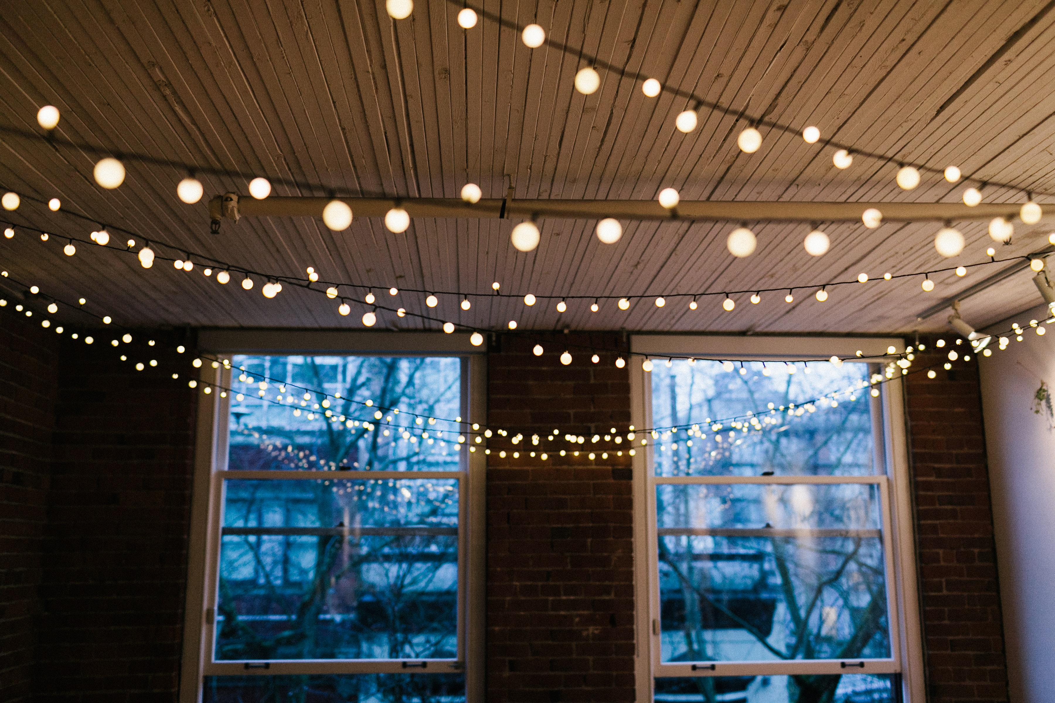 white window panel with string lights