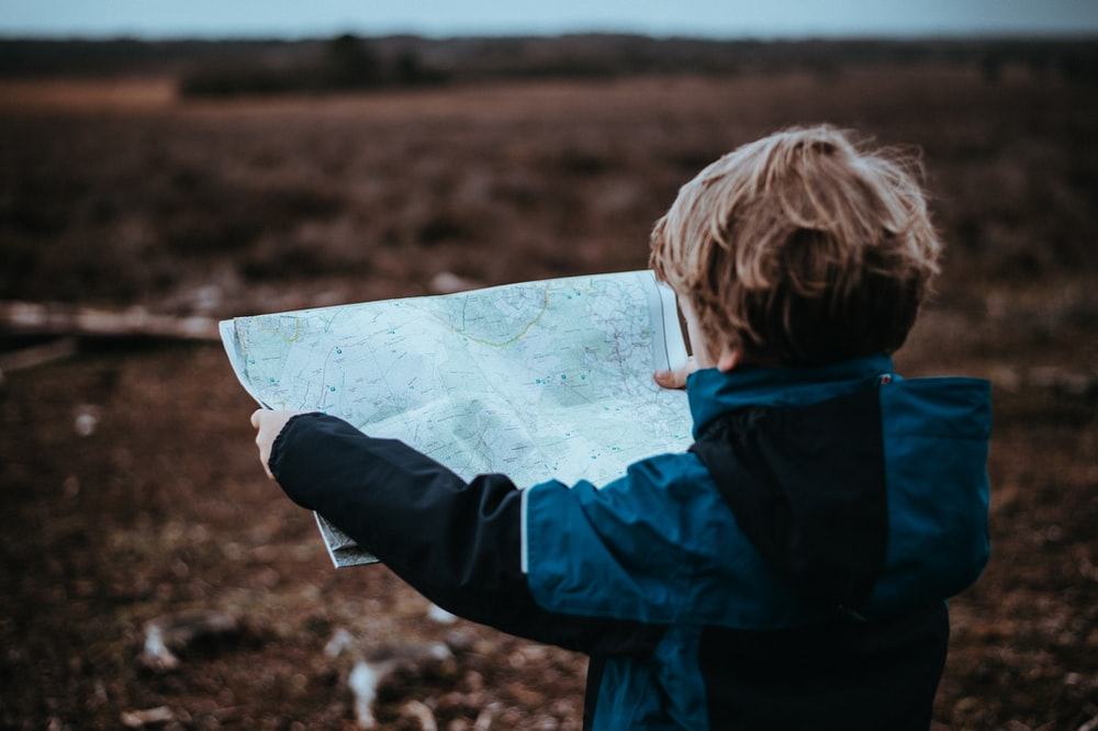 child looking at map