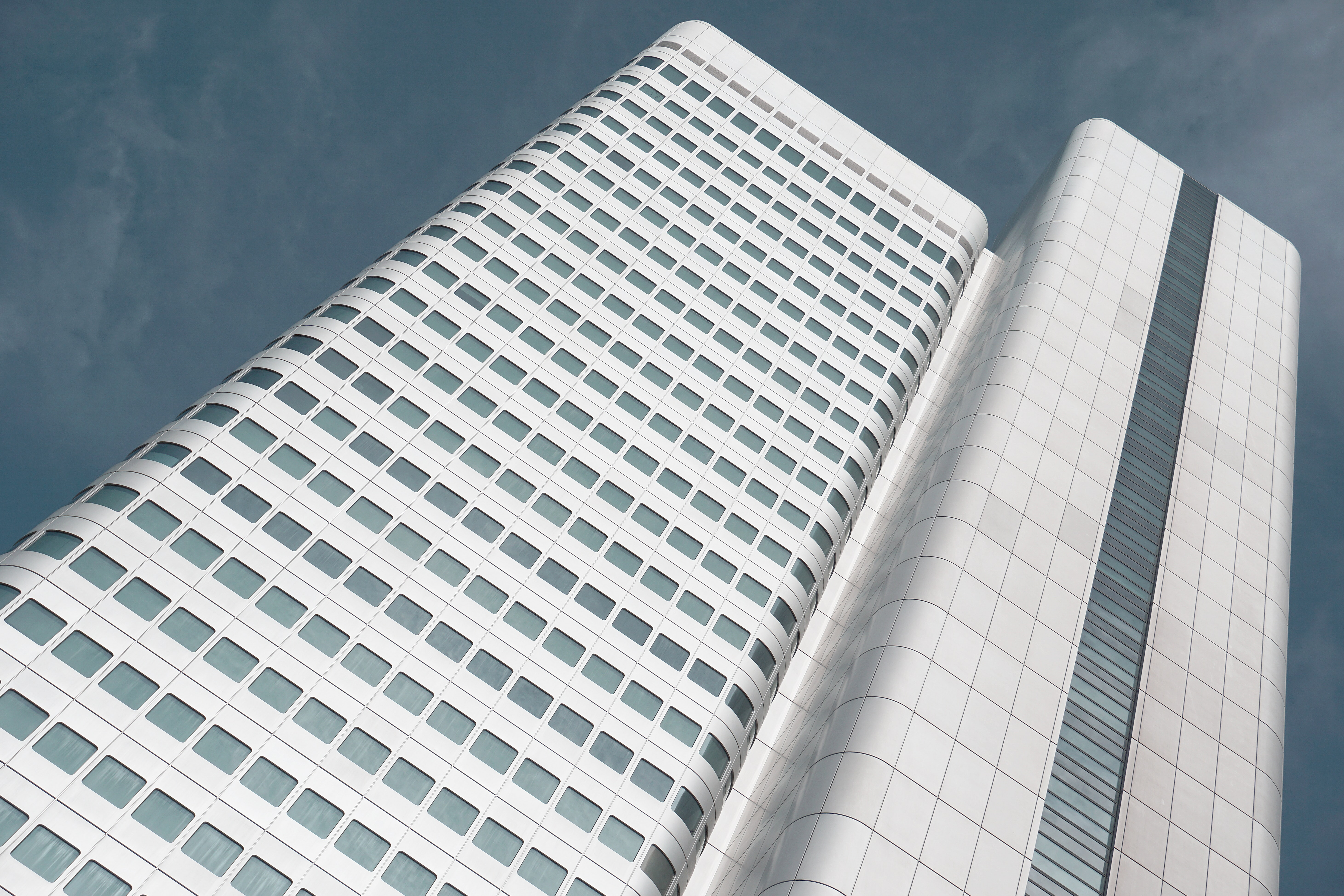 A modern white office building with rounded corners in Frankfurt