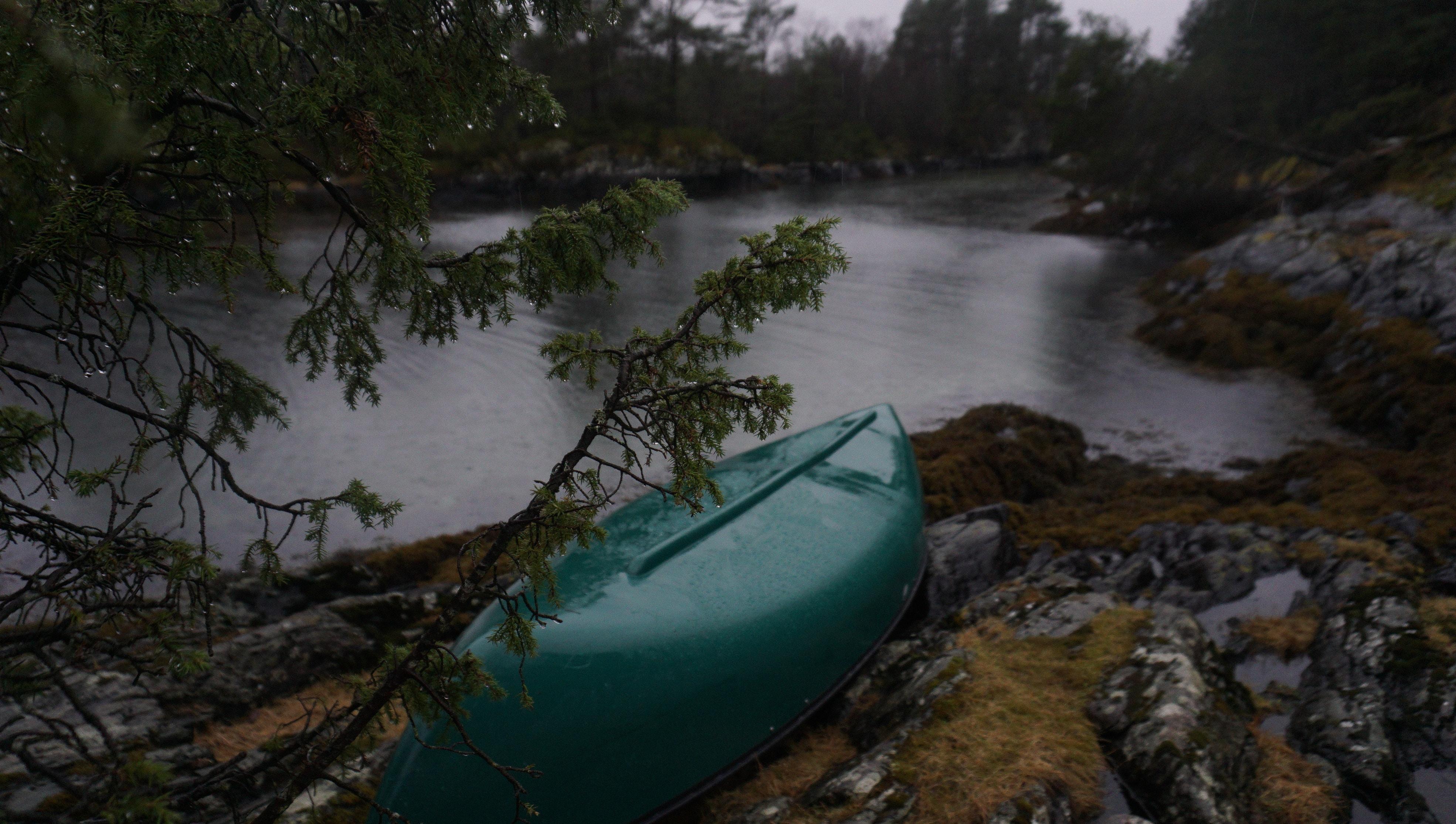 green kayak on rocky river