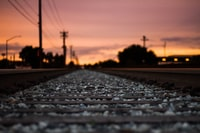 shallow focus photography of train track
