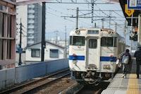 white train passing on subway